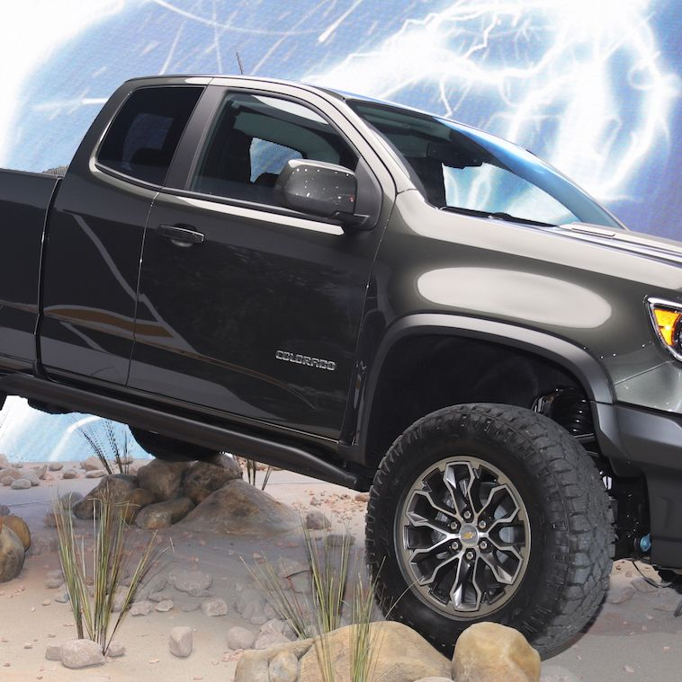"""<p>The <a href=""""http://www.roadandtrack.com/car-shows/news/a31614/the-chevy-colorado-zr2-is-the-last-old-school-off-roader/"""" target=""""_blank"""" data-tracking-id=""""recirc-text-link"""">Chevrolet Colorado ZR2</a> was a pleasant surprise. Chevy got in the factory off-roader game kind of late, but the <a href=""""http://www.roadandtrack.com/new-cars/future-cars/news/a31584/the-chevrolet-colorado-zr2-will-be-your-favorite-off-road-truck/"""" target=""""_blank"""" data-tracking-id=""""recirc-text-link"""">ZR2 has hardware</a> that'll make it a serious challenge to the F-150 Raptor. It's an old-school off-roader, and we can't wait to try it.</p>"""