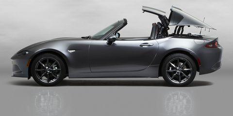 Automotive design, Vehicle, Alloy wheel, Performance car, Car, Rim, Fender, Convertible, Sports car, Roadster,