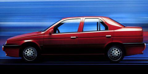 Tire, Wheel, Vehicle, Automotive design, Land vehicle, Automotive parking light, Car, Red, Vehicle door, Rim,