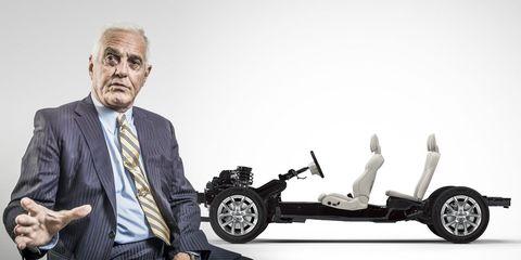Tire, Wheel, Automotive design, Dress shirt, Collar, Suit, Tie, Auto part, Rim, Blazer,