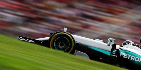Automotive tire, Formula racing, Formula one, Race track, Formula one car, Logo, Racing, Race car, Formula one tyres, Open-wheel car,