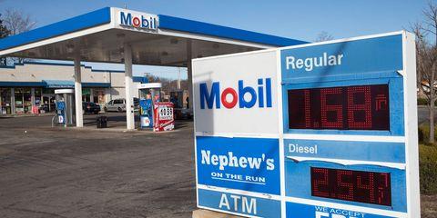 Logo, Gas, Automotive tail & brake light, Filling station, Signage, Fuel, Advertising, Gasoline, Gas pump, Machine,