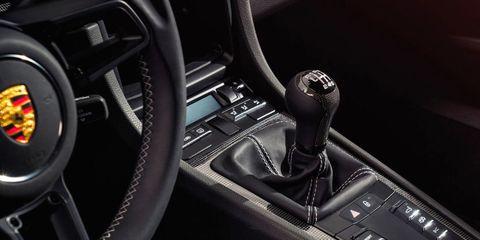 Steering part, Automotive design, Steering wheel, Center console, Personal luxury car, Luxury vehicle, Carbon, Gear shift, Black, Vehicle door,