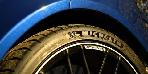 Tire, Motor vehicle, Wheel, Automotive tire, Blue, Automotive design, Automotive wheel system, Rim, Spoke, Synthetic rubber,