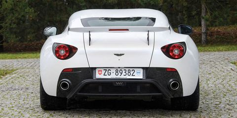 Mode of transport, Automotive design, Vehicle, Performance car, Automotive lighting, Supercar, Car, Red, White, Vehicle registration plate,