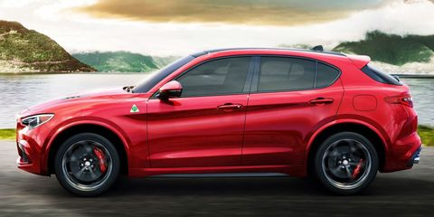 Land vehicle, Vehicle, Car, Motor vehicle, Automotive tire, Automotive design, Tire, Rim, Red, Alloy wheel,