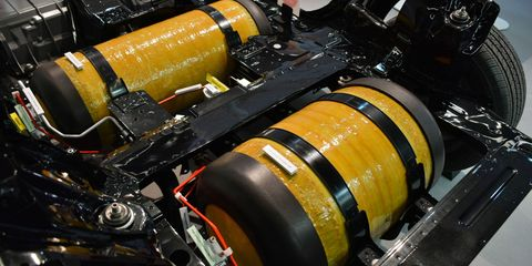 Yellow, Amber, Engine, Engineering, Pipe, Machine, Automotive engine part, Cylinder, Synthetic rubber, Steel,