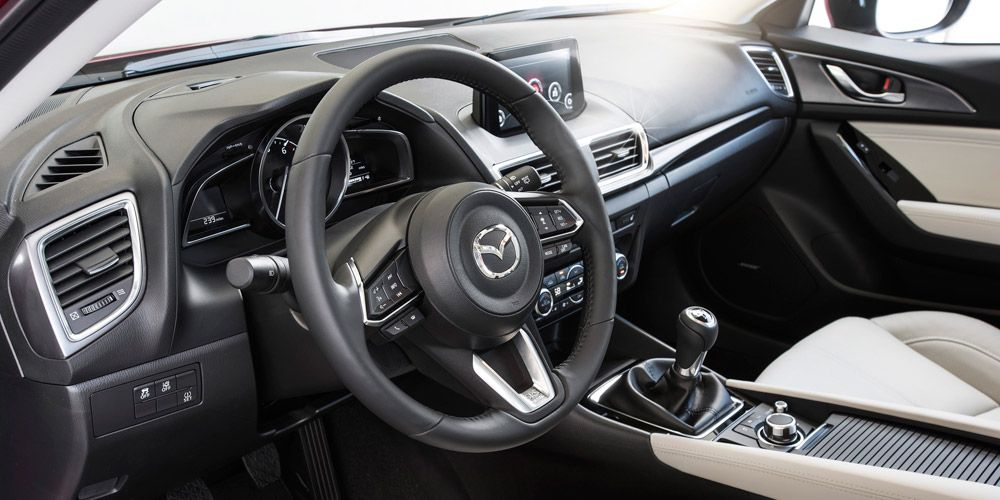 <p>Large-diameter, wood-rimmed steering wheels used to be de rigueur in sports cars, but factors such as crash standards and quicker steering ratios have dictated today's smaller, thicker wheels. These are carefully sculpted, with notches for your thumbs and well-integrated secondary controls. Often, the wheel isn't entirely round: a flat-bottom indicates performance intent. Leather or Alcantara wrapping adds both functionality and a premium aspect. The stitching needs to be just right, though. And try to avoid heat-absorbing, metallic trim strips over the circumference. </p>