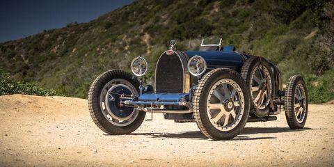 Tire, Wheel, Automotive design, Automotive tire, Rim, Terrain, Hill, Tread, Classic, Spoke,