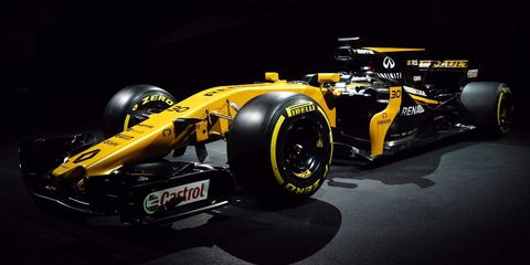 Tire, Motor vehicle, Wheel, Automotive tire, Automotive design, Open-wheel car, Formula one tyres, Yellow, Formula one car, Automotive wheel system,