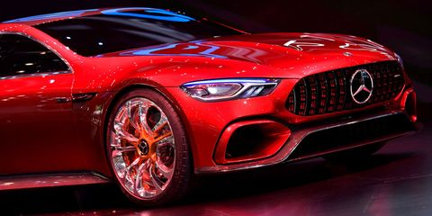 Tire, Wheel, Automotive design, Vehicle, Land vehicle, Event, Automotive lighting, Car, Red, Headlamp,