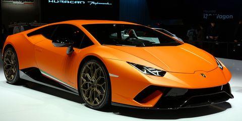 Land vehicle, Vehicle, Car, Sports car, Supercar, Auto show, Automotive design, Lamborghini, Motor vehicle, Yellow,