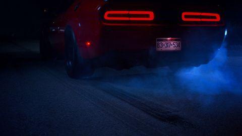 Automotive tail & brake light, Mode of transport, Automotive exterior, Automotive design, Automotive lighting, Red, Vehicle registration plate, Automotive parking light, Auto part, Supercar,
