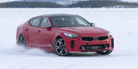 Tire, Wheel, Automotive design, Vehicle, Winter, Red, Car, Performance car, Rim, Snow,