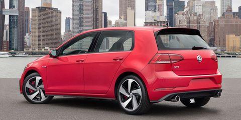 Land vehicle, Vehicle, Car, Motor vehicle, Automotive design, Alloy wheel, Volkswagen, Red, Luxury vehicle, Hatchback,