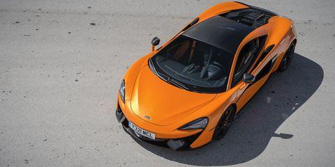 Land vehicle, Vehicle, Car, Supercar, Automotive design, Sports car, Mclaren automotive, Orange, Mclaren mp4-12c, Yellow,