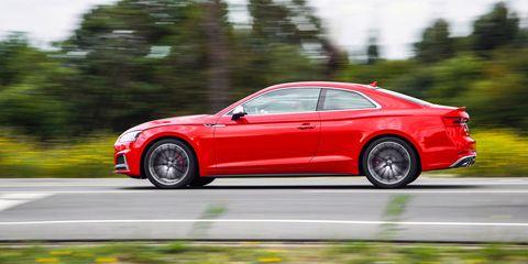 Tire, Wheel, Automotive design, Alloy wheel, Vehicle, Rim, Red, Spoke, Car, Performance car,