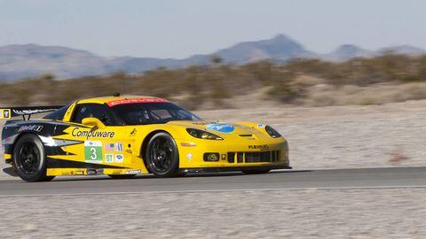 Tire, Wheel, Automotive design, Vehicle, Yellow, Land vehicle, Sports car racing, Motorsport, Race track, Car,