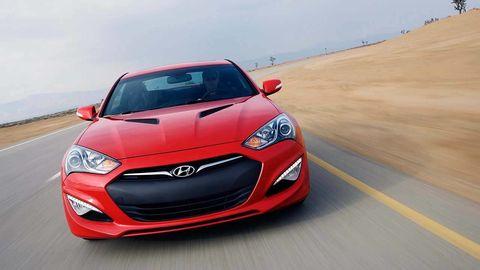 Motor vehicle, Automotive design, Daytime, Vehicle, Hood, Headlamp, Red, Car, Grille, Automotive lighting,