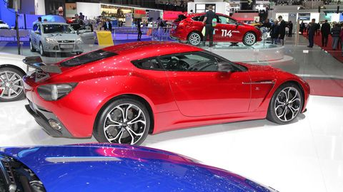 Tire, Wheel, Automotive design, Mode of transport, Vehicle, Event, Land vehicle, Car, Performance car, Red,