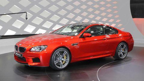 Tire, Wheel, Automotive design, Vehicle, Performance car, Car, Rim, Hood, Alloy wheel, Red,