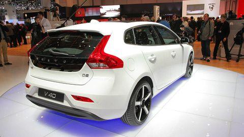 Automotive design, Vehicle, Land vehicle, Event, Car, Hatchback, Exhibition, Vehicle registration plate, Auto show, Bumper,
