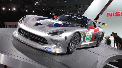 Automotive design, Vehicle, Performance car, Headlamp, Car, Sports car, Supercar, Automotive lighting, Race car, Logo,