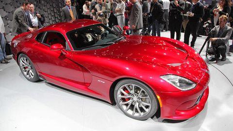 Tire, Wheel, Automotive design, Vehicle, Land vehicle, Event, Performance car, Rim, Red, Car,