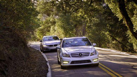 Automotive design, Vehicle, Land vehicle, Road, Grille, Automotive lighting, Car, Automotive exterior, Automotive mirror, Automotive parking light,