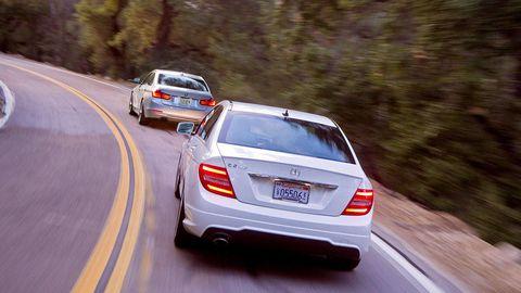 Motor vehicle, Automotive tail & brake light, Mode of transport, Automotive design, Road, Vehicle, Automotive lighting, Land vehicle, Automotive exterior, Car,