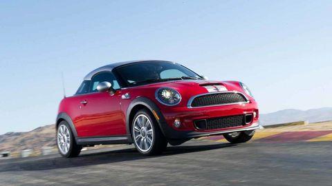 Tire, Wheel, Automotive design, Vehicle, Land vehicle, Automotive lighting, Automotive mirror, Spoke, Rim, Red,
