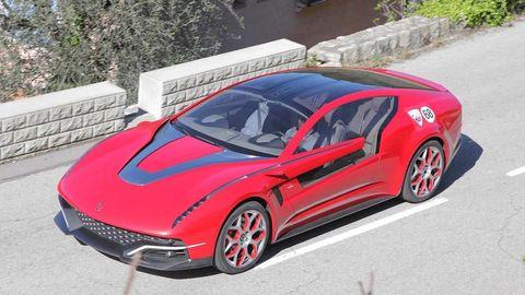 Tire, Wheel, Mode of transport, Automotive design, Automotive mirror, Vehicle, Car, Hood, Red, Rim,