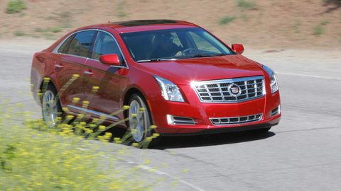 Motor vehicle, Vehicle, Land vehicle, Transport, Infrastructure, Car, Red, Grille, Technology, Full-size car,