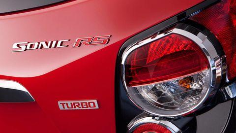 Motor vehicle, Automotive tail & brake light, Automotive design, Automotive lighting, Vehicle, Automotive exterior, Red, Logo, Light, Automotive light bulb,