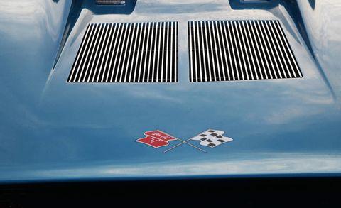 Motor vehicle, Blue, Automotive exterior, Hood, Grille, Azure, Electric blue, Symbol, Symmetry, Classic,