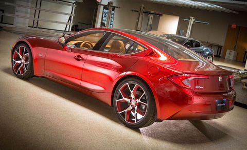 Tire, Wheel, Mode of transport, Automotive design, Vehicle, Land vehicle, Rim, Car, Performance car, Red,
