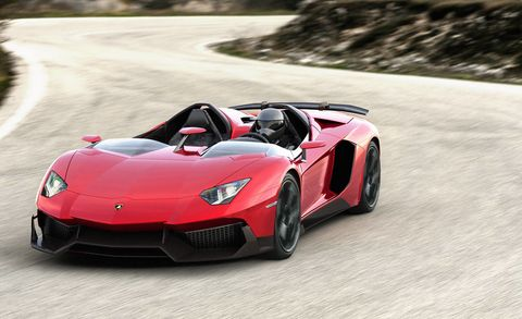 Tire, Mode of transport, Automotive design, Vehicle, Performance car, Infrastructure, Road, Car, Supercar, Red,