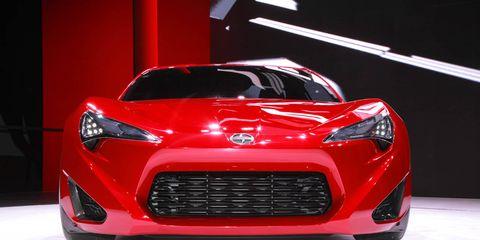 Motor vehicle, Automotive design, Product, Event, Grille, Automotive lighting, Car, Red, Headlamp, Performance car,