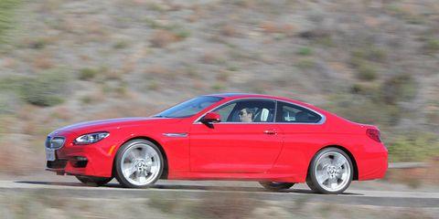 Tire, Wheel, Vehicle, Automotive design, Land vehicle, Window, Alloy wheel, Rim, Car, Red,
