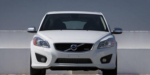 Motor vehicle, Automotive design, Blue, Mode of transport, Daytime, Automotive mirror, Vehicle, Hood, Automotive lighting, Glass,