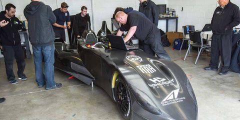 Automotive design, Shoe, Automotive tire, Fender, Logo, Race car, Automotive wheel system, Auto part, Engineering, Formula one tyres,