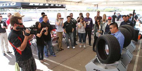 Jeans, Camera, Video camera, Television crew, Camera operator, Videographer, Journalist, Backpack, Photographer, Digital camera,