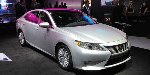 Vehicle, Automotive design, Event, Land vehicle, Car, Technology, Glass, Auto show, Mid-size car, Luxury vehicle,