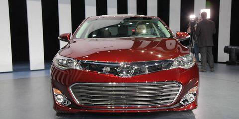 Automotive design, Mode of transport, Vehicle, Event, Land vehicle, Car, Grille, Headlamp, Mid-size car, Automotive lighting,