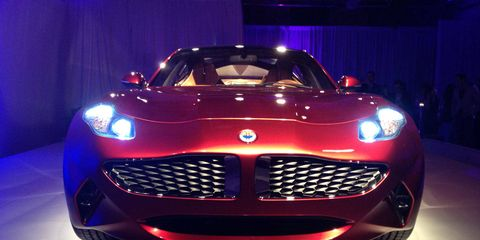 Mode of transport, Automotive design, Vehicle, Event, Grille, Performance car, Red, Automotive lighting, Car, Supercar,