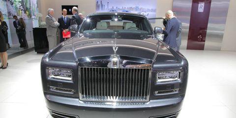 Automotive design, Vehicle, Grille, Car, Personal luxury car, Exhibition, Luxury vehicle, Auto show, Vehicle door, Classic car,