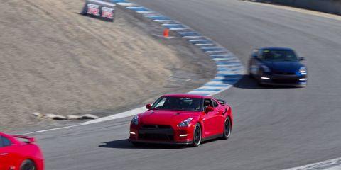 Tire, Automotive design, Vehicle, Land vehicle, Road, Car, Sports car racing, Performance car, Race track, Fender,