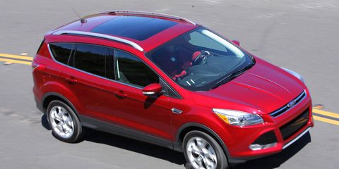 Tire, Wheel, Automotive design, Vehicle, Automotive tire, Land vehicle, Car, Red, Automotive mirror, Automotive lighting,