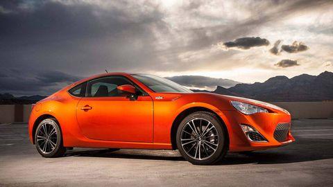 Tire, Wheel, Automotive design, Vehicle, Automotive lighting, Rim, Car, Orange, Supercar, Performance car,