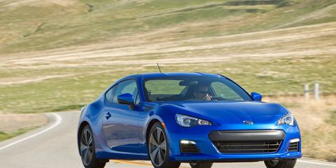 Tire, Wheel, Automotive design, Blue, Vehicle, Rim, Infrastructure, Performance car, Hood, Car,
